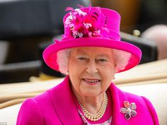 Wonderful: The Queen, radiant in a gorgeous hot pink coat and matching hat by Angela Kelly, beamed as she was driven along the racecourse at Ascot 20 June 2014