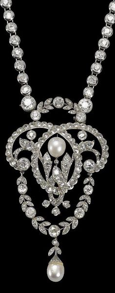 A vintage platinum, pearl and diamond necklace, France, 1920-30s. In the Belle Epoque taste, the necklace set with brilliant-cut diamonds, suspending a detachable pendant wtih a pearl in a garland set wtih brilliant and rose-cut diamonds, suspending a pear-shaped pearl, mounted in platinum. With Swedish import marks for platinum. Pendant 7cm long. #vintage #necklace