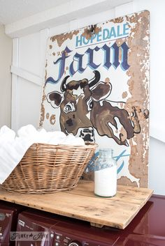 Cow farm sign in a laundry room / Funky new boarded wall for the laundry room via FunkyJunkInteriors.net