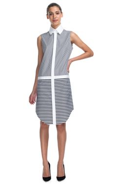 This contrast stripe shirtdress features a solid pointed collar, solid white trim at waist and placket, and a shirttail hem Concealed button placket at front 100% cotton