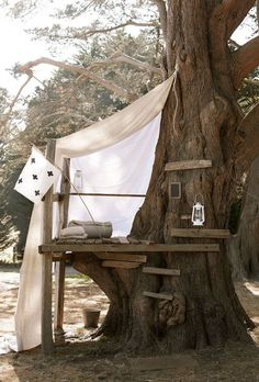 Now that spring is in full swing, I'm itching to do a DIY project. If you recall, we have an awesome maple tree in our front yard, and what better project to take on than a cool tree house for the kiddo? Of course, that means I scoured Pinterest for some fun back yard ideas and tree houses for kids that are actually doable for someone like me. Here's what I've found! This simple treehouse looks like so much fun! They added a tent on top and a slackline for practicing balancing. vi...