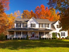 A house in the country with a wrap around porch