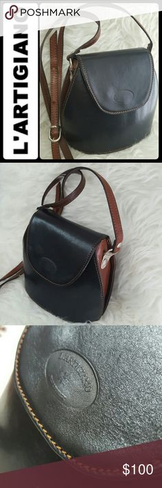 L'Artigiano Italy Leather Crossbody Bag L'Artigiano Designer Leather Crossbody Bag in Gorgeous Black and Brown Colors! Sturdy Built Structured Shape in Genuine Leather Material! Timeless Italian Luxury!  Made in Italy, Adjustable Crossbody Strap, Front Flap Magnetic Closure Opens to Fully Lined Interior, Silver Tone Hardware, Used in Mint Condition! L'Artigiano  Bags Crossbody Bags