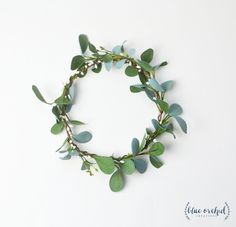 Is there anything more boho than a crown made of greenery and flowers?