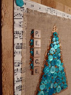 Vintage blue buttons, burlap, antique sheet music and Scrabble tiles on pallet board. Retro Christmas, Christmas Items, Pallet Boards, Scrabble Tiles, Repurposed Items, Sheet Music, Burlap, Buttons, Create
