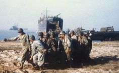 U.S. troops and equipment land at Salerno, Italy in September 1943