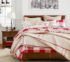 Love layered bedding with mixed textures in neutral and rich reds for the holidays.