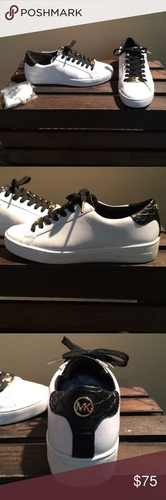Micheal Kors sneakers White and black sneakers with gold accents. Slightly worn, comes with an extra pair of white shoe laces. Black Sneakers, Shoes Sneakers, Michael Kors Sneakers, White Shoes, Gold Accents, Cleats, Sassy, Fashion Design, Fashion Trends