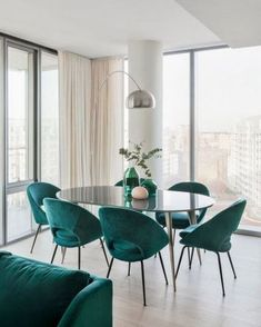 Withholding nothing, we pulled out all the stops for this two bedroom apartment's bold color palette. Check out this eye-catching space from featuring our Orb Velvet Dining Chairs + Arden Dining Table!Teal and cream dining room with mid century mod Mid Century Modern Dining Room, Modern Dining Room Tables, Luxury Dining Room, Mid Century Dining Chairs, Dining Room Lighting, Dining Room Design, Dining Room Chairs, Dining Room Furniture, Design Room