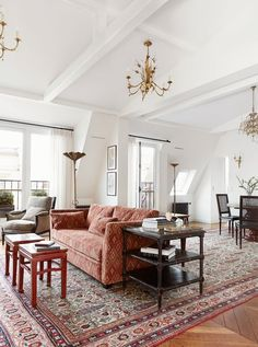 Sitting on the top floor, this large and beautiful Paris apartment overlooks the boulevard St. What a beautiful location, and what a gorgeous apartment. Rugs In Living Room, Living Spaces, Living Room Decor Inspiration, Paris Apartments, Apartment Design, Decoration, House Design, Interior Design, Interior Ideas