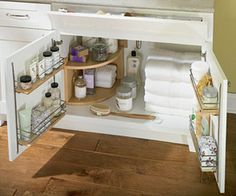 Organize a bathroom vanity using kitchen cabinet storage items.