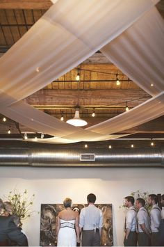 Ceiling decorations: Clever fabric hung from ceiling and crossed to create a tented effect #ceilingdecor #weddingideas