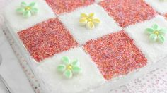 Blogger Heather Baird of  SprinkleBakes uses sanding sugar to create quilt squares on this cake.
