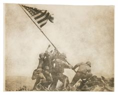 Five Marines and one Navy corpsman raise Old Glory on Mount Suribachi after taking Iwo Jima in 1945.