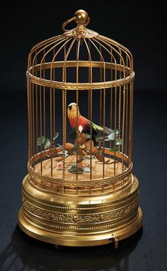 Charming Swiss Mechanical Singing Bird in a Gilded Cage. http://Theriaults.com
