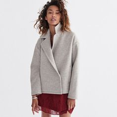 Made of double-faced melton, this cozy jacket has a fresh, swingy shape. The…