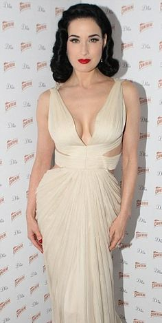 726988c45bd Retro glamour  Dita Von Teese looked stunning in her revealing gown