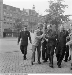 German soldier is apprehended by Dutch citizens. Rokin, Amsterdam, The Netherlands (1945).