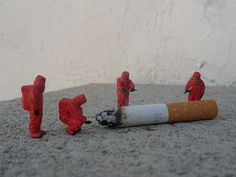 Slinkachu - miniature street art artist LOVE the hazmat suits.