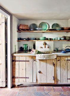 Rustic Kitchen by Axel Vervoordt and Alessio Lipari Architects and Serena Mignatti Architect in Rome, Italy