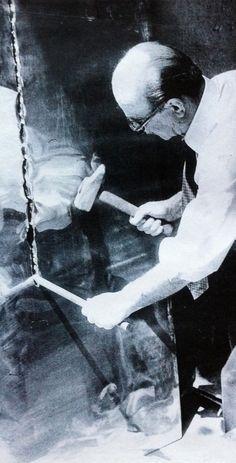 Lucio Fontana working in his studio