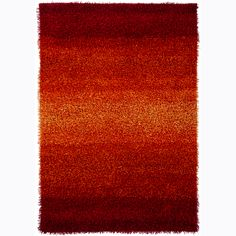 Enhance your home decor with this handmade Mandara shag rug. This thick and plush rug is hand woven in India and features shag pattern in shades of red and rust orange.