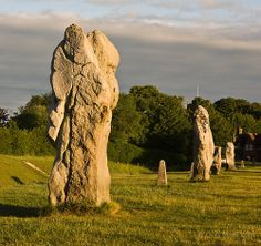 Standing Stones at Avebury  Neolithic henge monument containing three stone circles, around the village of Avebury in Wiltshire, in southwest England.