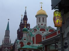 Russian doll sign vs Kremlin spires in Moscow by NoSoma, via Flickr