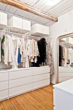 Simple storage. Plain white chest of drawers (Ikea?) with hanging rails