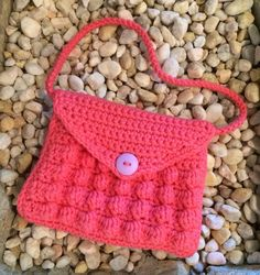 """""""This purse is a fun use of the bobble stitch. Its crocheted in one piece, with optional side panels available for added capacity. Make the strap as short or long as you want, or omit it completely for a fun clutch look. Purse Patterns Free, Crochet Purse Patterns, Bag Pattern Free, Childs Purse Pattern, Crochet Toddler, Crochet Girls, Crochet For Kids, Crochet Ideas, Crochet Projects"""