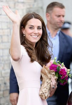 The Duchess showed off her perfect pearly whites as she beamed at onlookers...
