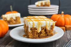 The ultimate fall dessert! A pumpkin spice cake is drizzled with caramel sauce, frosted with a decadent cream cheese frosting and topped with even more caramel sauce! You'll love every single morsel of this uber moist, delicious cake!