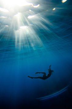 girl dives underwater
