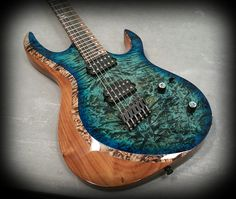 Kiesel Guitars Carvin Guitars AM6 (Aries Multiscale) translucent aquaburst over burl maple top on walnut body with Royal ebony fretbaord,