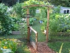 More open gate withs Hogwire behind?  Rounded arbor?
