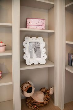 Too cute!  Fitted furniture for a girl's bedroom.  Hand make and painted grey to set of all those favourite, treasured toys  (some pink!) Made by Dunham Fitted Furniture.