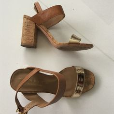 Beautiful tan sandals gold strap cork heels. Worn 2x about 3.5 inches heel label is US 6 and EU 37.  Fits more like 6.5. Brazilian brand Shoes Sandals