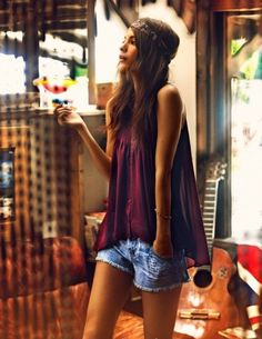 """""""Bohemian style"""" inspiration. My way: Long denim shorts and black drapey tank over cami or white flared graphic tank. Natural makeup and long beachy waves. Headband (optional). Key necklace."""