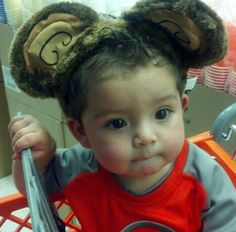 Christian and his monkey ears at party city!! :)