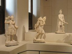 """Marble sculptures from the mithraeum at Sidon in Lebanon, dated AD 389, on display in the New Galleries of the Louvre (""""The Roman Empire in the Eastern Mediterranean"""").  At center is Mithras, who is carrying the bull to sacrifice, flanked by his companions Cautes and Cautopates with their torches symbolizing life and death, beginnings and endings, day and night, etc. The mithraeum was discovered in 1887 by Edmond  Durighello, an eccentric antique dealer who did not reveal its exact…"""