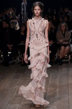 Rooney, 30, wowed in a semi-sheer ruffled gown for her big night, showing off her svelte figure in the pale pink number.