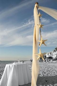 beach wedding... Much simpler than a full 4 post bamboo arbor and just as elegant... Loving this