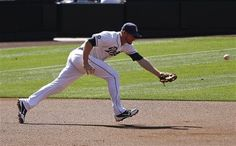 Game #114 8/8/12: San Diego Padres third baseman Chase Headley cannot hold on to an infield single by Chicago Cubs' Welington Castillo during the second inning of a baseball game on Wednesday, Aug. 8, 2012, in San Diego. (AP Photo/Lenny Ignelzi)