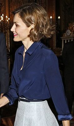 Navy silk shirt (unidentified). Debuted May 2015