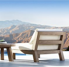 RH's Merida Lounge Chair:Created by Belgian designer Xavier Van Lil, this collection takes inspiration from the classic 1950s slipper chair. Composed of bold teak timbers acutely angled to maximize both aesthetics and ease, the low profile and clean lines evoke a singularly minimalist point of view.