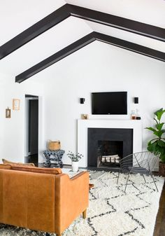 Vaulted ceiling with black painted beams