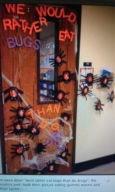 "Door for Drug Free week: ""We would rather eat bugs that do drugs!"", decorated with spiders, webs, and pictures of students eating gummy worms"