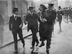 1914: Emmeline Pankhurst being arrested at the demonstration outside Buckingham Palace, London.