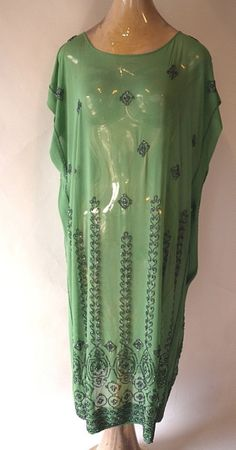 Egyptian Revival Gun Metal Beaded 1920's Georgette Dress. This gorgeous dress is a unique jade green and sparkling gun metal bead color combination and has a touch of the exotic with a definite Egyptian art deco patterned beading. Front