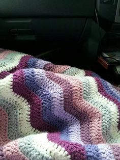 This is attic24's free neat ripple pattern using stylecraft dk special yarn in silver  grape  plum old rose violet and wisteria and cream the whole blanket cost 20.00 australian